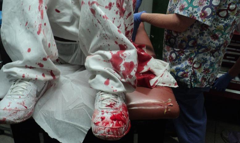 Alabama prisoner in blood-soaked clothing